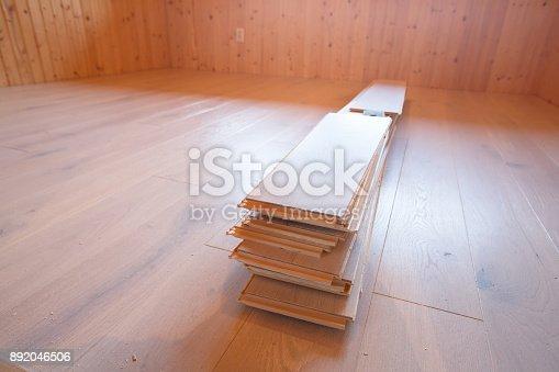 istock Home improvement, new parquet flooring 892046506
