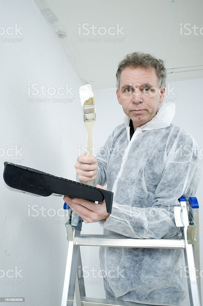 Home improvement series. House painter. royalty-free stock photo