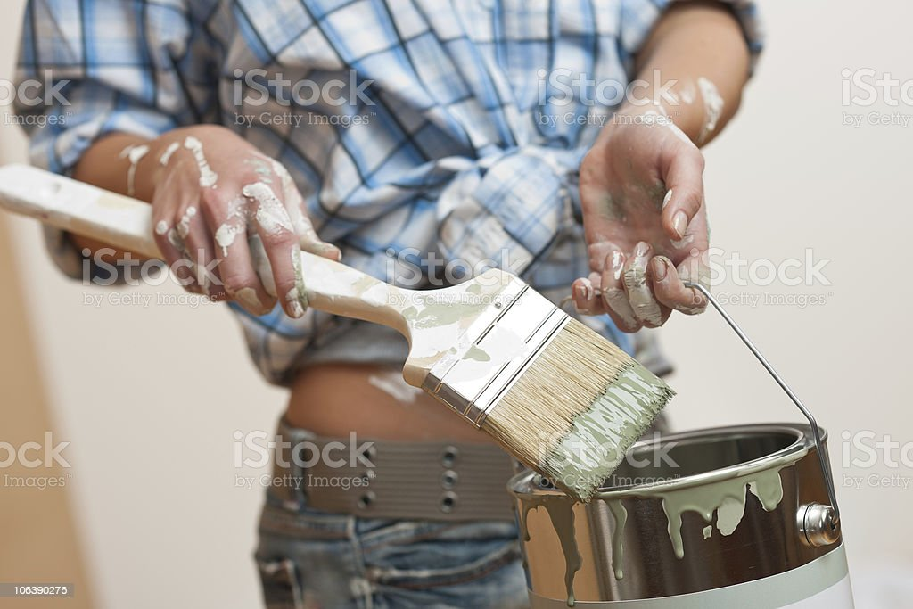 Home improvement: Woman holding paint brush royalty-free stock photo