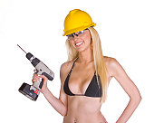 Model in bikini holds up cordless drill