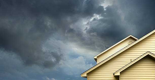 home in stormy day stock photo