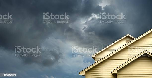 Photo of home in stormy day