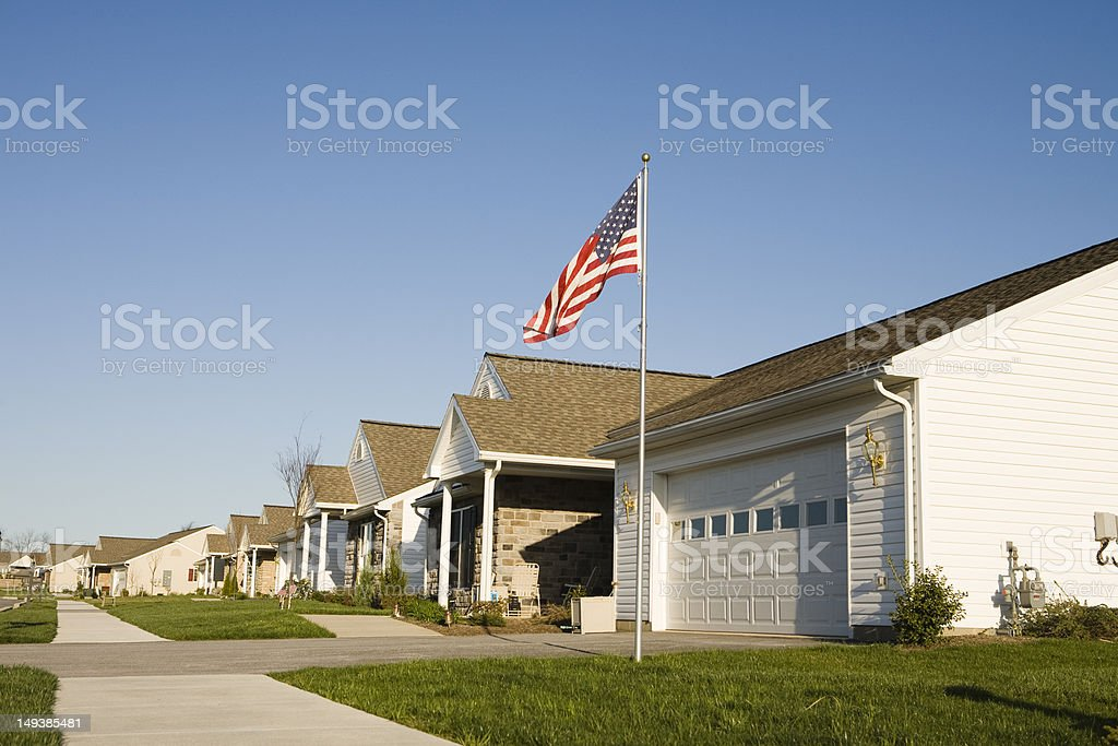 Home inside of a development with an American Flag stock photo