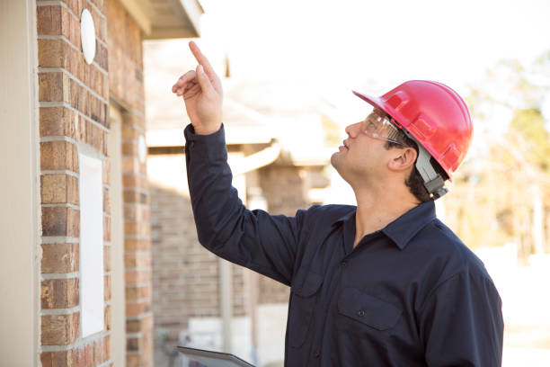 home inspector examines recent construction using digital tablet. - quality control stock photos and pictures