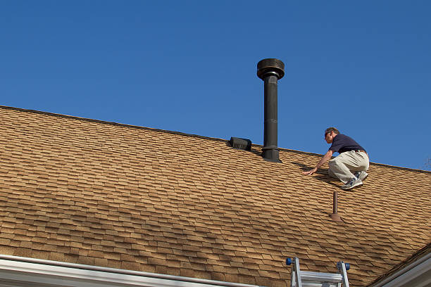 home inspector, on the roof, examines a roof gas vent. - quality control stock photos and pictures