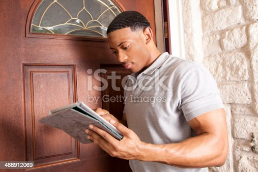 istock Home inspector, repairman arrives at customer house. Digital tablet. 468912069