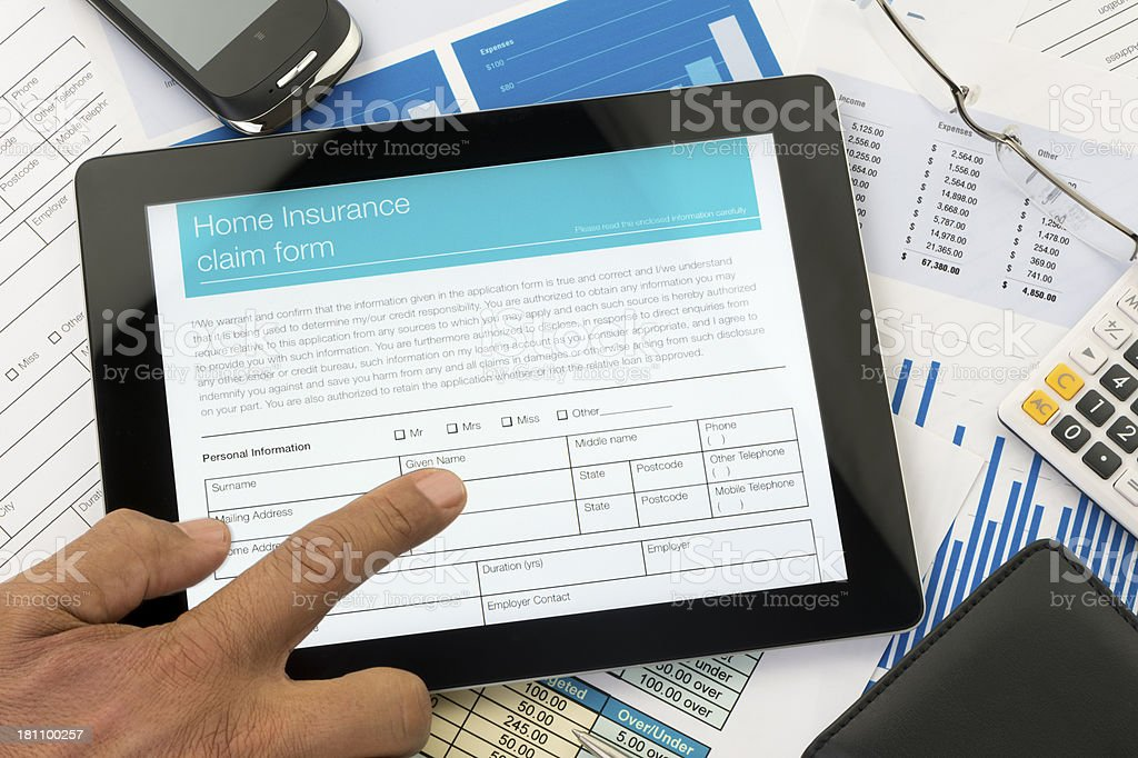 Home insurance claim form on a digital tablet royalty-free stock photo