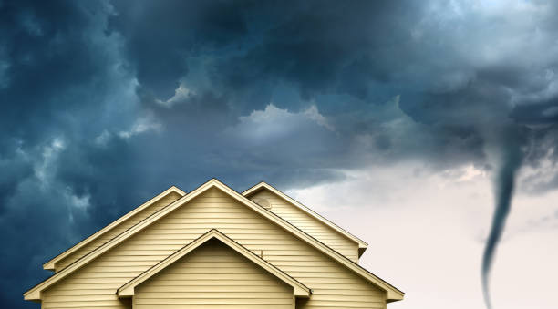 home insurance concept of house and tornado stock photo