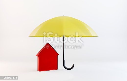 Home insurance concept. Red house icon standing under the yellow umbrella. Horizontal composition with copy space.
