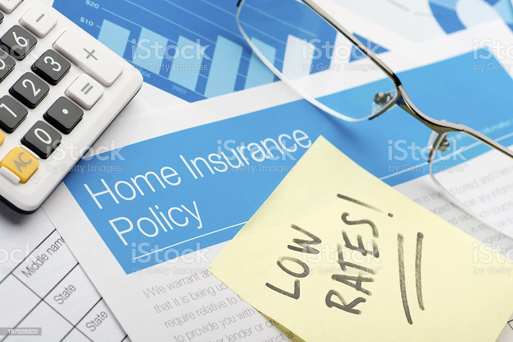 Home insurance policy with low rates note royalty-free stock photo