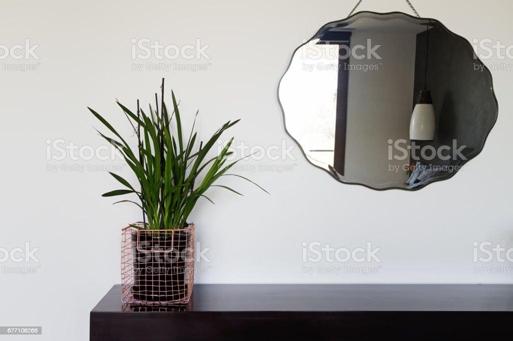 Home interior decor details copper wire basket and mirror stock photo