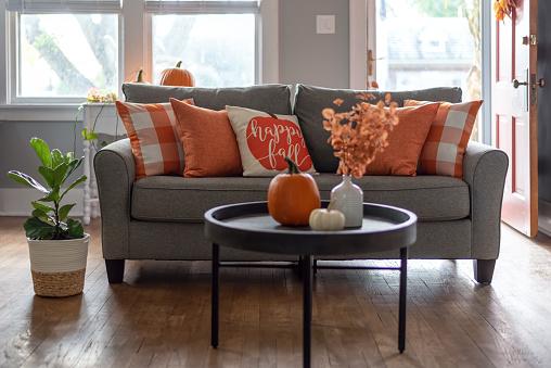 Happy fall throw pillow on the sofa for autumn season home decor