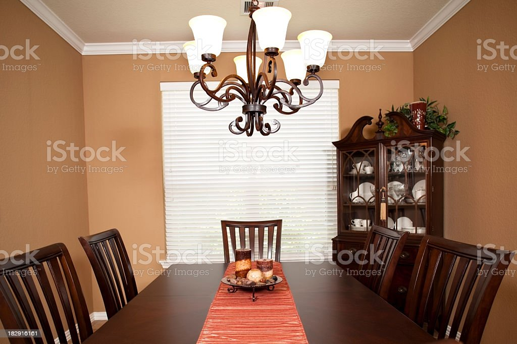 Home interior dining table, chairs and china cabinet chandelier stock photo
