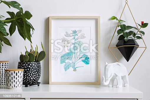Interior floral poster mock up with vertical wooden frame. Concept with navy blue shelf