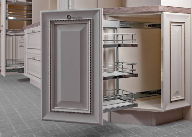home interior. kitchen - opened door with furniture. wood and chrome material, modern design. - kitchen counter imagens e fotografias de stock