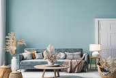 istock Home interior mock-up with blue sofa, wooden table and decor in blue living room 1300125969