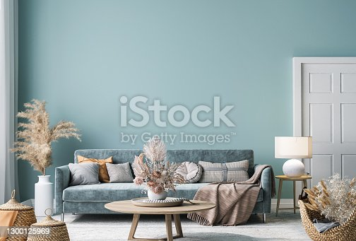 Home interior mock-up with blue sofa, wooden table and decor in blue living room, 3d render
