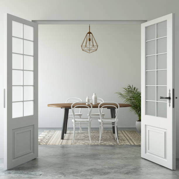 Home interior open door dining room Open doors showing modern hipster vintage interior with dining table and chairs. pendant above. green plant, and cement floor with vintage rug. daylight scene template. cement floor stock pictures, royalty-free photos & images