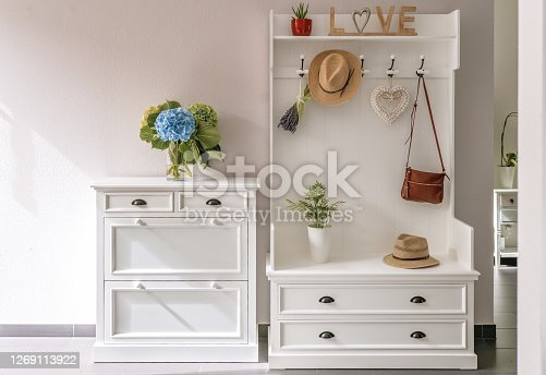 istock Home interior. White wooden furniture at entryway. Small foyer organisation decision. 1269113922