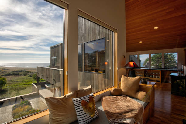 Home Interior: window seat by oceanfront home in California stock photo