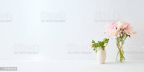 Home interior with decor elements pink peonies in a vase and white picture id1187845245?b=1&k=6&m=1187845245&s=612x612&h=jfu ek5juqlkbcfnha6rukz1pd7jewax84tsfxbhdse=