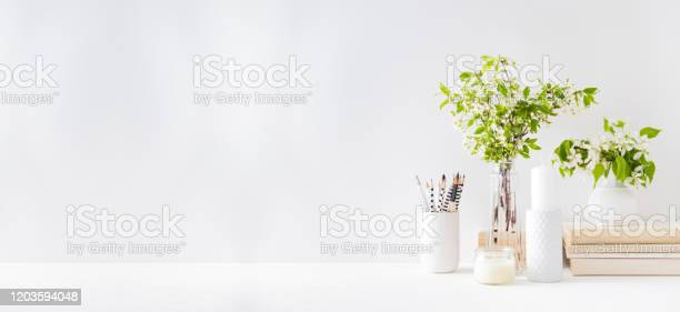 Home interior with decor elements spring flowers in a vase office on picture id1203594048?b=1&k=6&m=1203594048&s=612x612&h=68mdhlewpye5g2g jybmvbrwiuc3gcin9gxi0w lvx0=