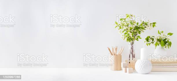Home interior with decor elements spring flowers in a vase office on picture id1203997285?b=1&k=6&m=1203997285&s=612x612&h=ybvdpwzjp3jehv6viamw2cj8lbkpq8d0bwspd4i3qco=