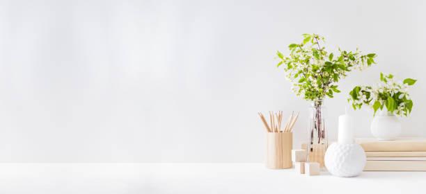 Home interior with decor elements spring flowers in a vase office on picture id1203997285?b=1&k=6&m=1203997285&s=612x612&w=0&h=s 6iv4qn9b 570tnlyfnqksmjtk8ml nvuhho74wijw=