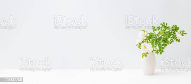 Home interior with decor elements white small flowers and green in a picture id1225632205?b=1&k=6&m=1225632205&s=612x612&h=gvxvvsaajl20l7afcelhmkd1wqg5wqj k82a7vakr3q=