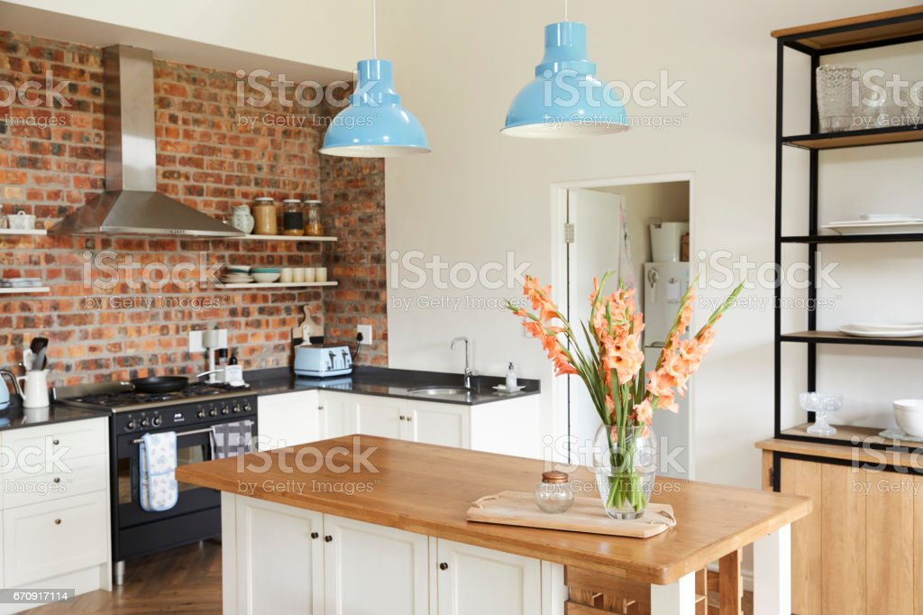 Home Interior With Open Plan Kitchen, Lounge And Dining Area stock photo