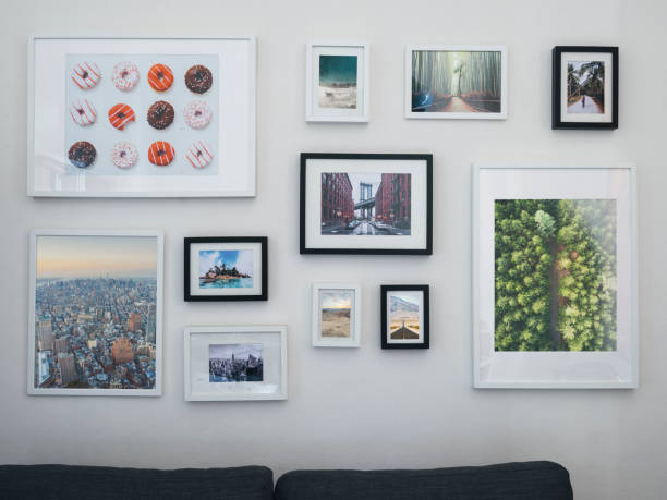Home interior with sofa and paintings on the wall stock photo