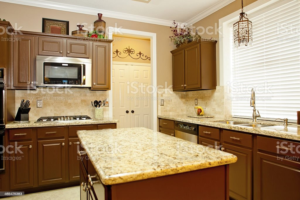 Home Interiors Kitchen With Granite Stainless Appliances Island Foreground Stock Photo Download Image Now Istock