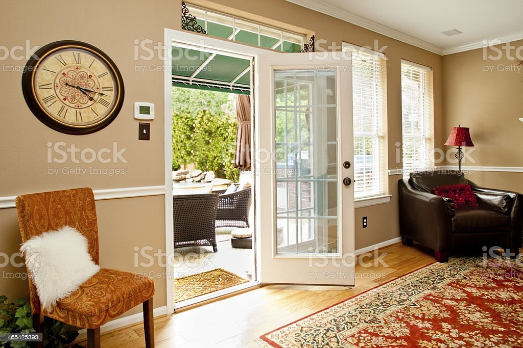Home Interiors: Living room with back door open to patio. stock photo