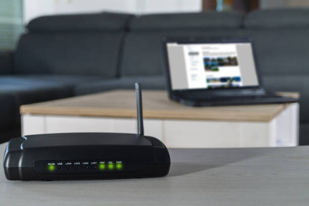 home internet router on desk. - беспроводные технологии стоковые фото и изображения