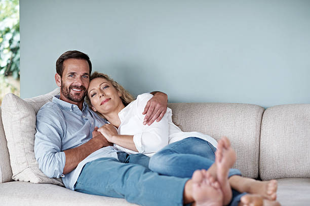 home is not a place, it's a feeling - mid adult couple stock pictures, royalty-free photos & images