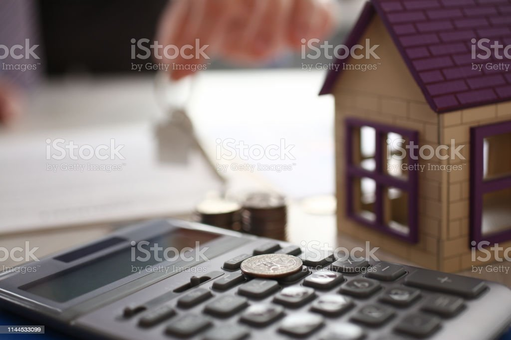 Home Keychain in Real Estate Agent Hand House Rent stock photo
