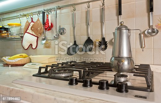 839034546 istock photo Home Kitchen with a Coffe Maker on the Stove 617894460