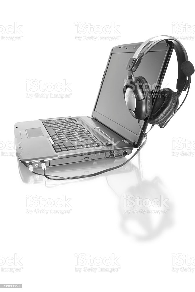 home laptop with stereo headset royalty-free stock photo