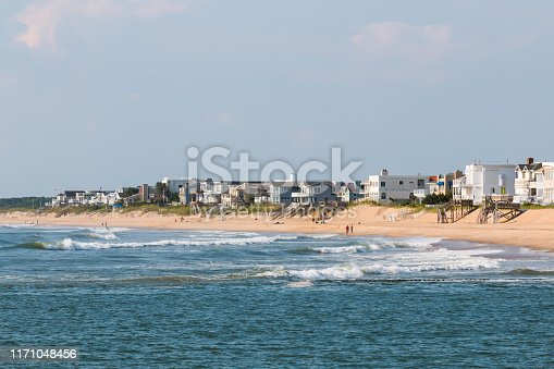 Homes line the Virginia Beach shore near the boardwalk and Rudee Inlet.