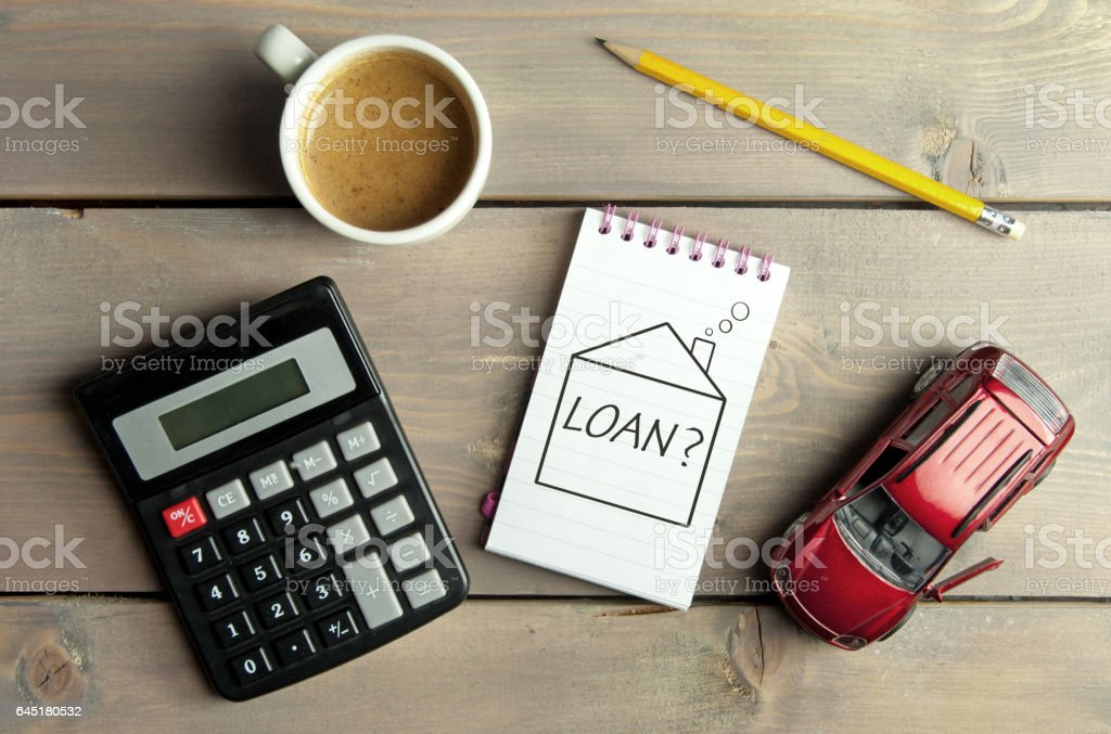 Home loan Notepad with loan question inside a sketch of a house with a miniature car and calculator Applying Stock Photo