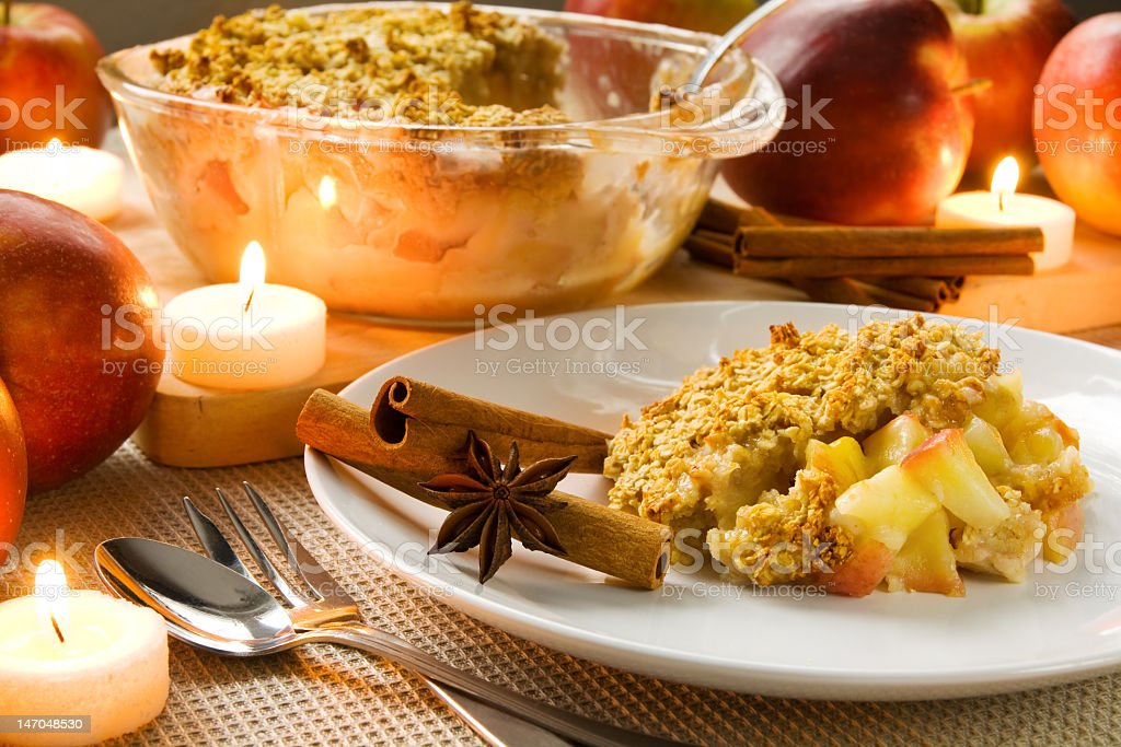 A home made apple crumble served on a white plate stock photo