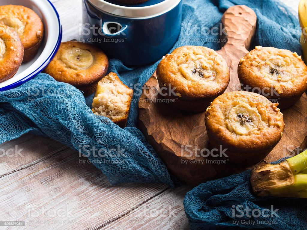 Home made banana muffins on serving board stock photo