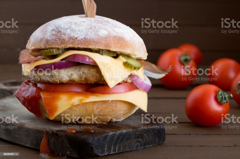 Home made big Burger on wooden background. stock photo