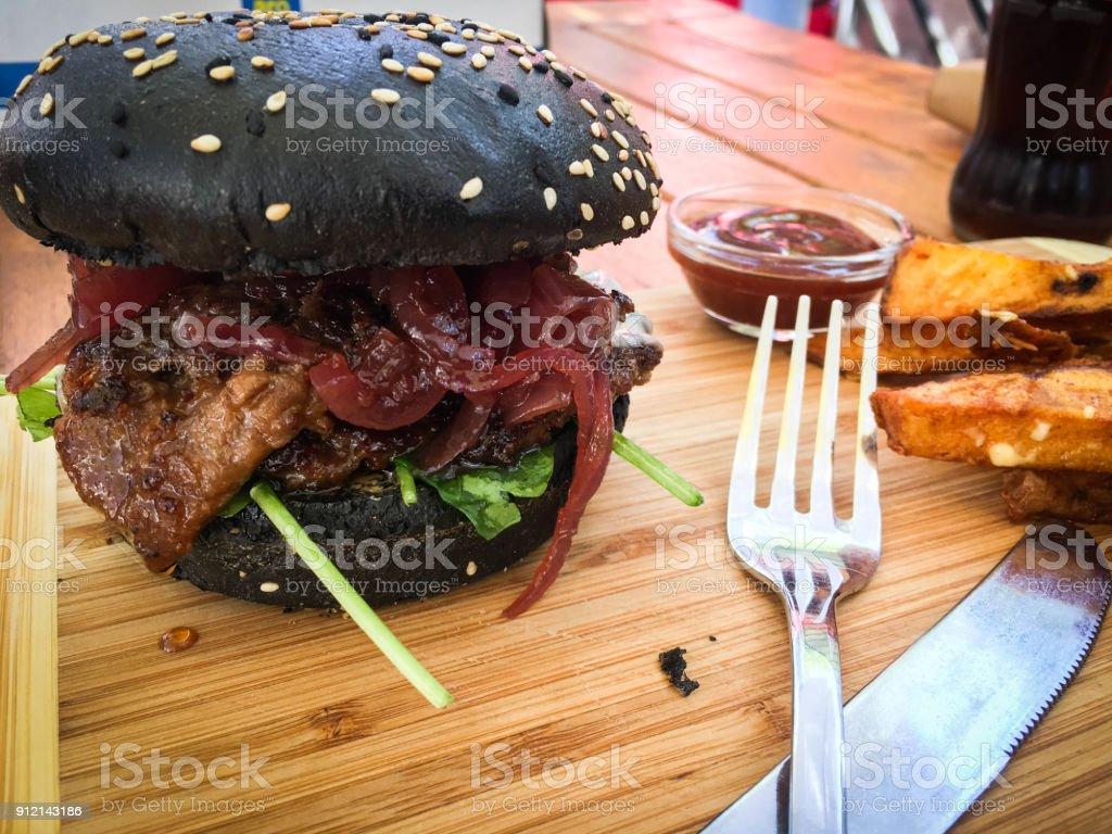 home made black burgers stock photo
