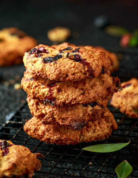 Home made Blueberry and walnut oat cookies on black background stock photo