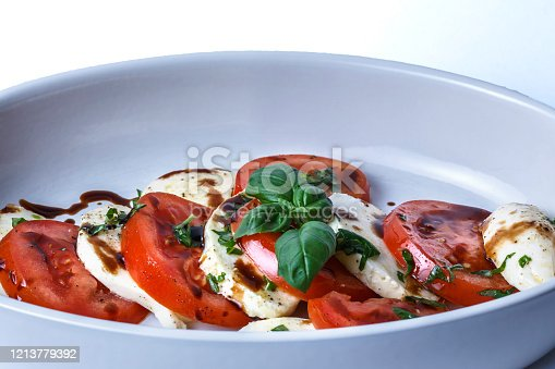 organic  fresh mozzarella, tomatoes, and basil salad