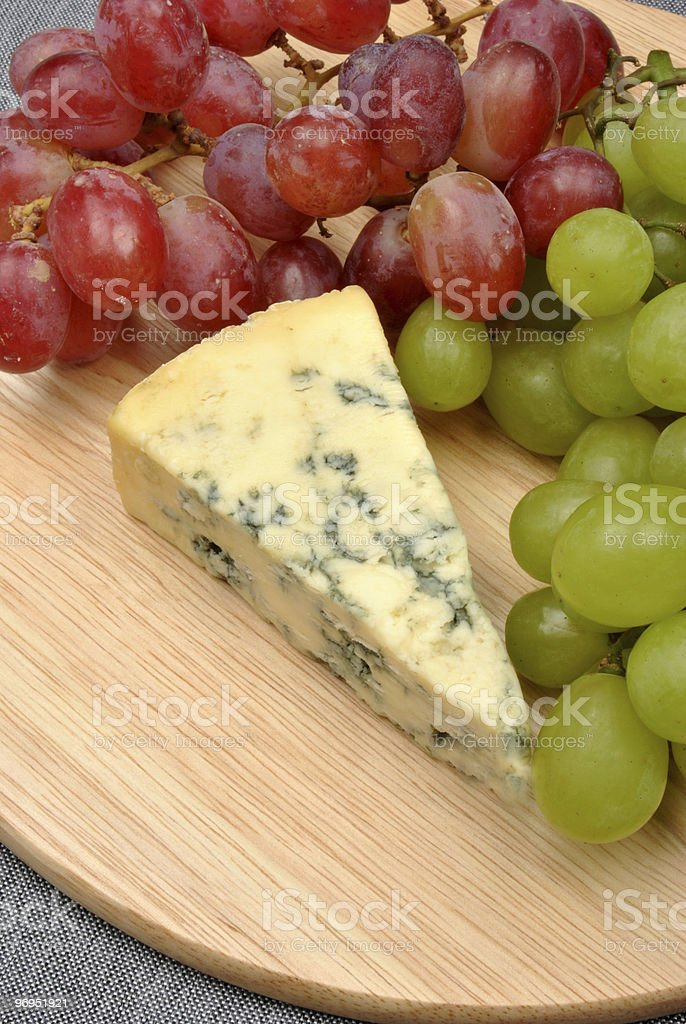 home made cheese with grapes in the background royalty-free stock photo