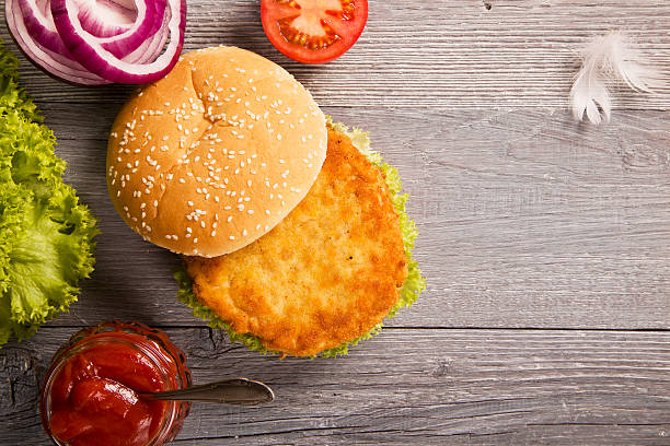 home made chicken burger with lettuce, tomato and onion - burger and chicken stok fotoğraflar ve resimler