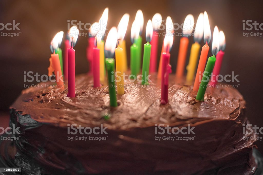 Home made chocolate cake with candles stock photo