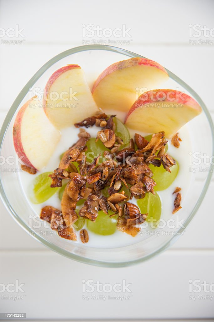 Home made granola with yoghurt, apple and grapes stock photo